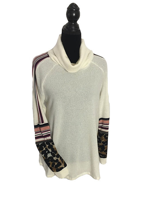 Ivory turtle neck with multi patterned sleeve detail