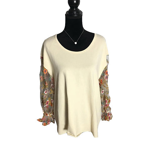 Cream colored top with sheer, floral embroidered sleeves