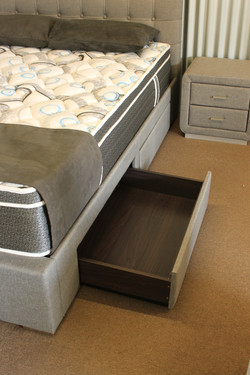 Bed with open drawer