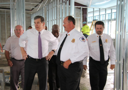 Gov. Roy Cooper is pictured during a visit to Fair Bluff on Monday, Aug. 13.