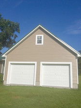 New garage with vinyl siding