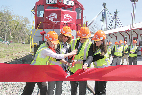Shawna Bramblett, Sandy Adams, Sen. Bill Rabon and April Colyer cut the ribbon Tuesday in Chadbourn to officially open R.J. Corman Railroad's Carolinas Line. Bramblett and Colyer are the daughters of the company's late founder, Rick Corman, and Adams is Corman's sister.