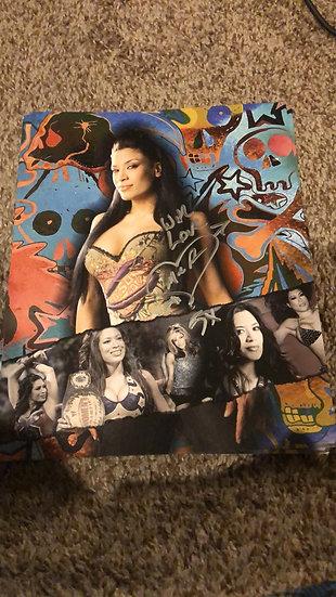 Melina autographed 8x10