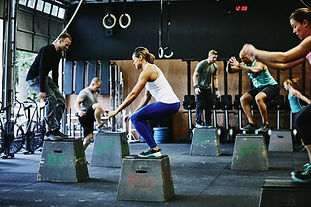 group-of-friends-doing-box-jumps-during-