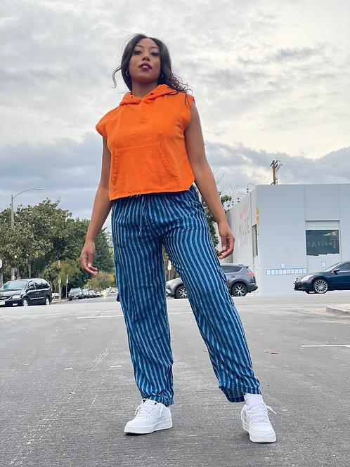 cropped orange hoodie + stripped blue pants