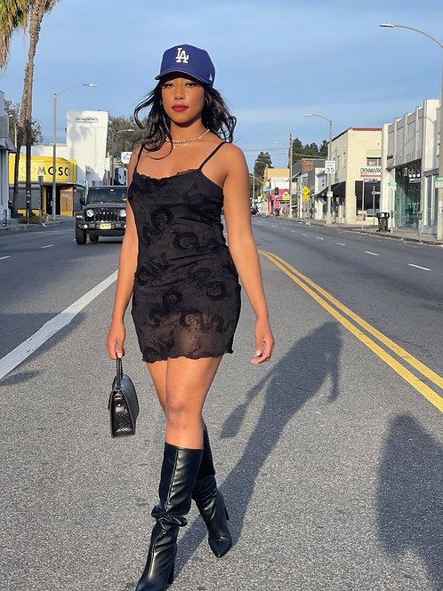 short black dress with snake designs
