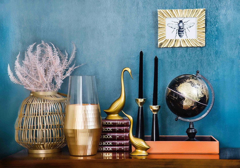 shelves and gold themed decor for the home