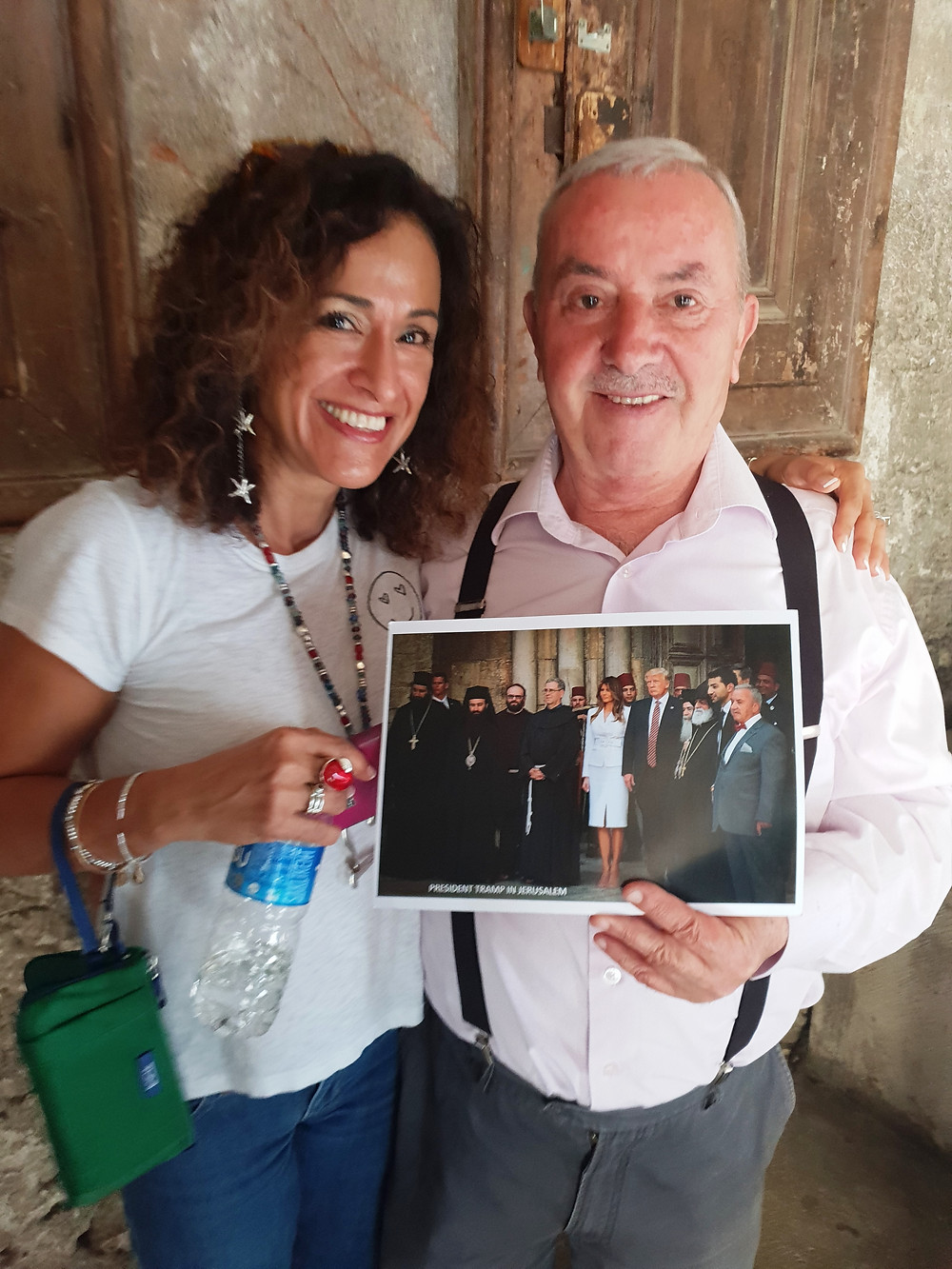 A tourst from Hawaii with the Holy Sepulcher Door Opener Mr. Nuseibeh, keeping his photo with President Trump