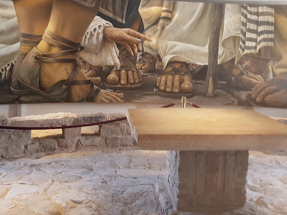 "Magdala' modern painting ""Woman Touching Jesus Clothese"" overlooking Magadala' 2,000 years old street pavements"