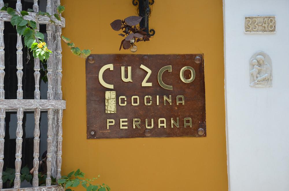 peruvian restaurant sign typography