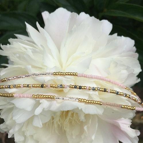 Nude, gold and grey 3 string bracelet