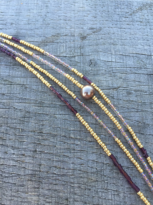 4 string bracelet with gold, grape or purple and beige