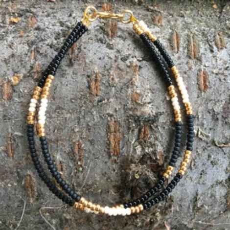 Black, white and gold pattern 2 string bracelet