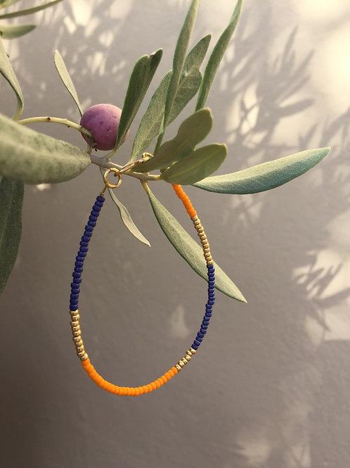 Orange, blue and gold bracelet single string