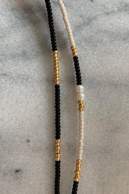 Black, gold and ivory white 2 string bracelet