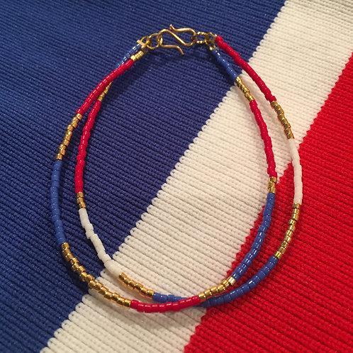 Blue, red, white and gold 2 string bracelet