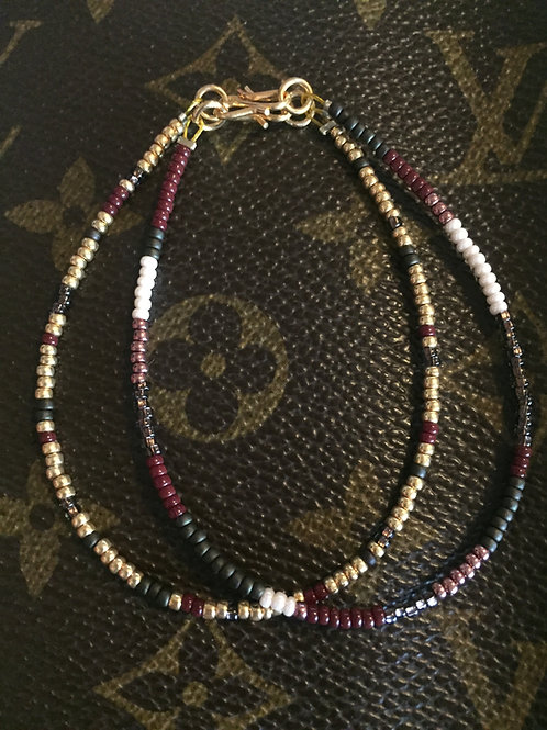 Army bracelet of 2 strings and gold