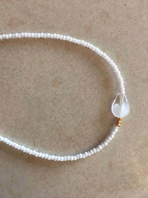 White bracelet with centered glass drop