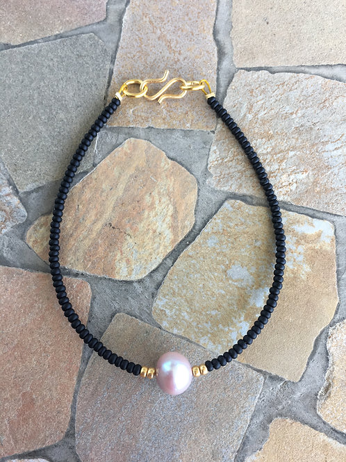 Black design with freshwater pearl