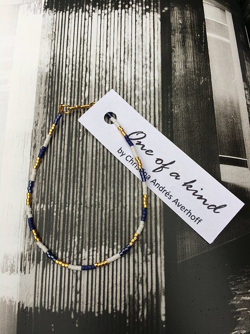 White, gold and shiny navy blue 1 string bracelet