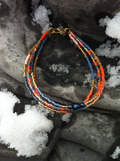 Orange, denim and gold bracelet of 4 strings