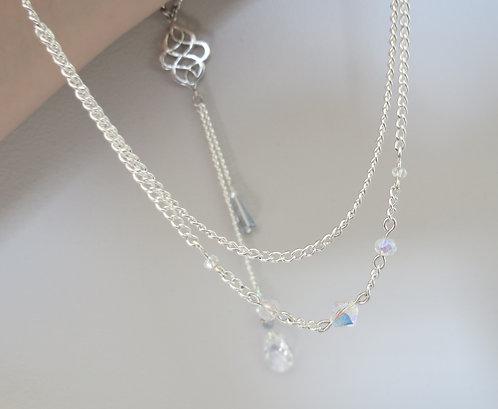 """Bijoux / Collier de Dos """"Charm"""" transparent, bleuté, gris"""