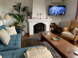Living room with fireplace and Smart TV.