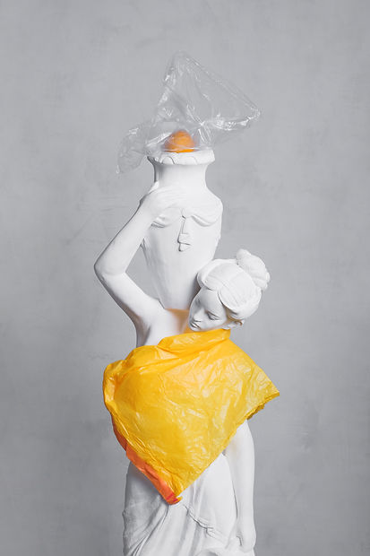 woman-white-sculpture-and-orange-plastic
