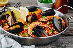 Paella with chorizo and seafood