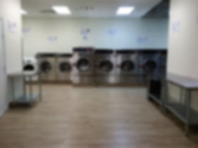large washing machine, large dryers, clean, bright, open early, open late, well maintained