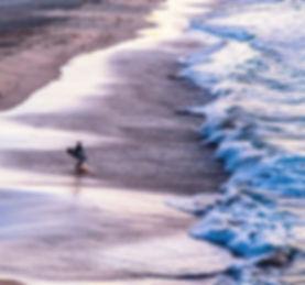 boy running on Bondi Beach