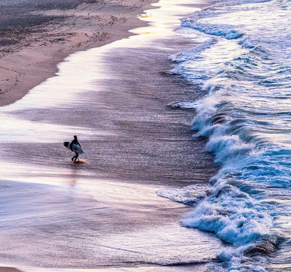 board rider into the surf