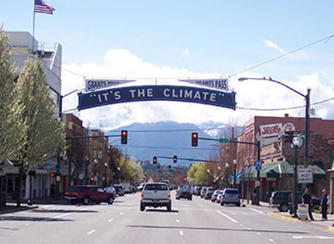 """It's the climate"" sign in downtown Grants Pass"