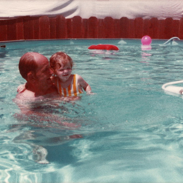 Grandpa keeping me safe in the pool