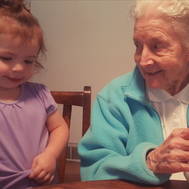 Eating popcorn with great grandmother