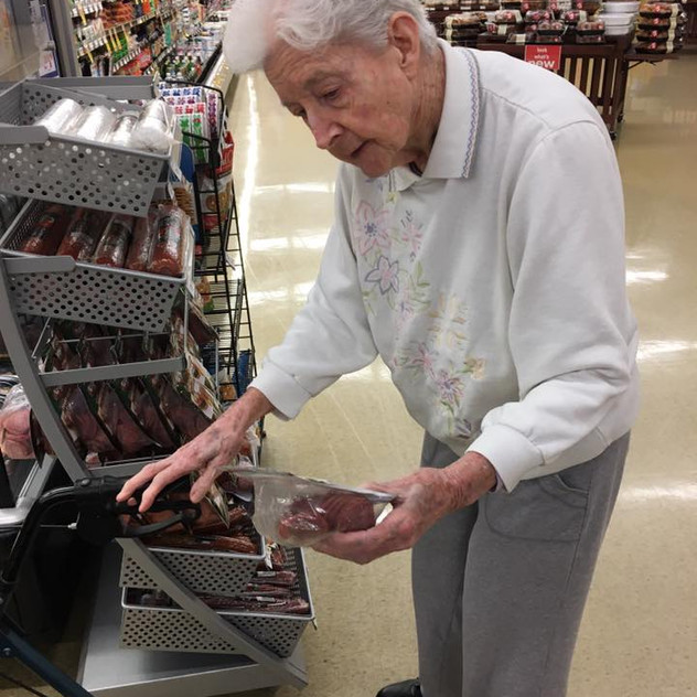 Gram shopping, carefully inspecting as she always did