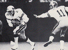 Bobby Hebert gives to Ken Lacy.jpg
