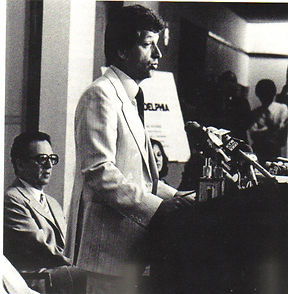Peterson at press conference with owner Myles H. Tanenbaum looking.jpg