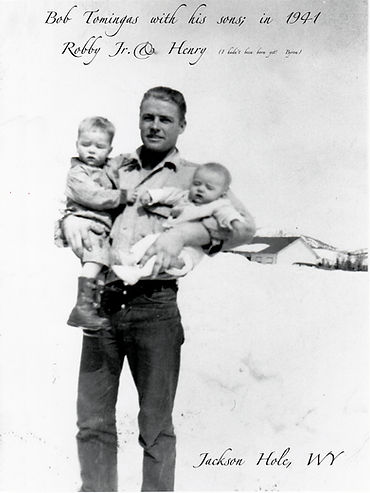 Dad holding my brothers.jpg