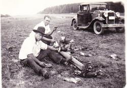Sitting by 1930 Car