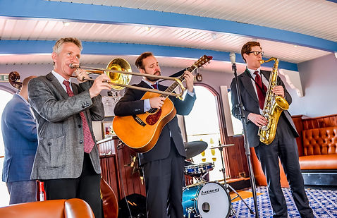 Playing on a riverboat on the river Thames
