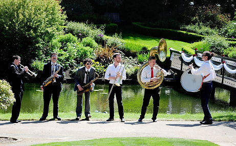 Brass Volcanoes playing acoustically for a wedding