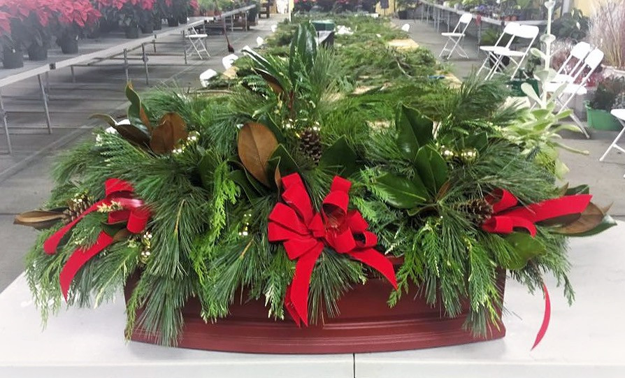 A special order.  This arrangement is comprised of additional greens and decorations.  It is actually three small porch pots combined to create one seamless display.