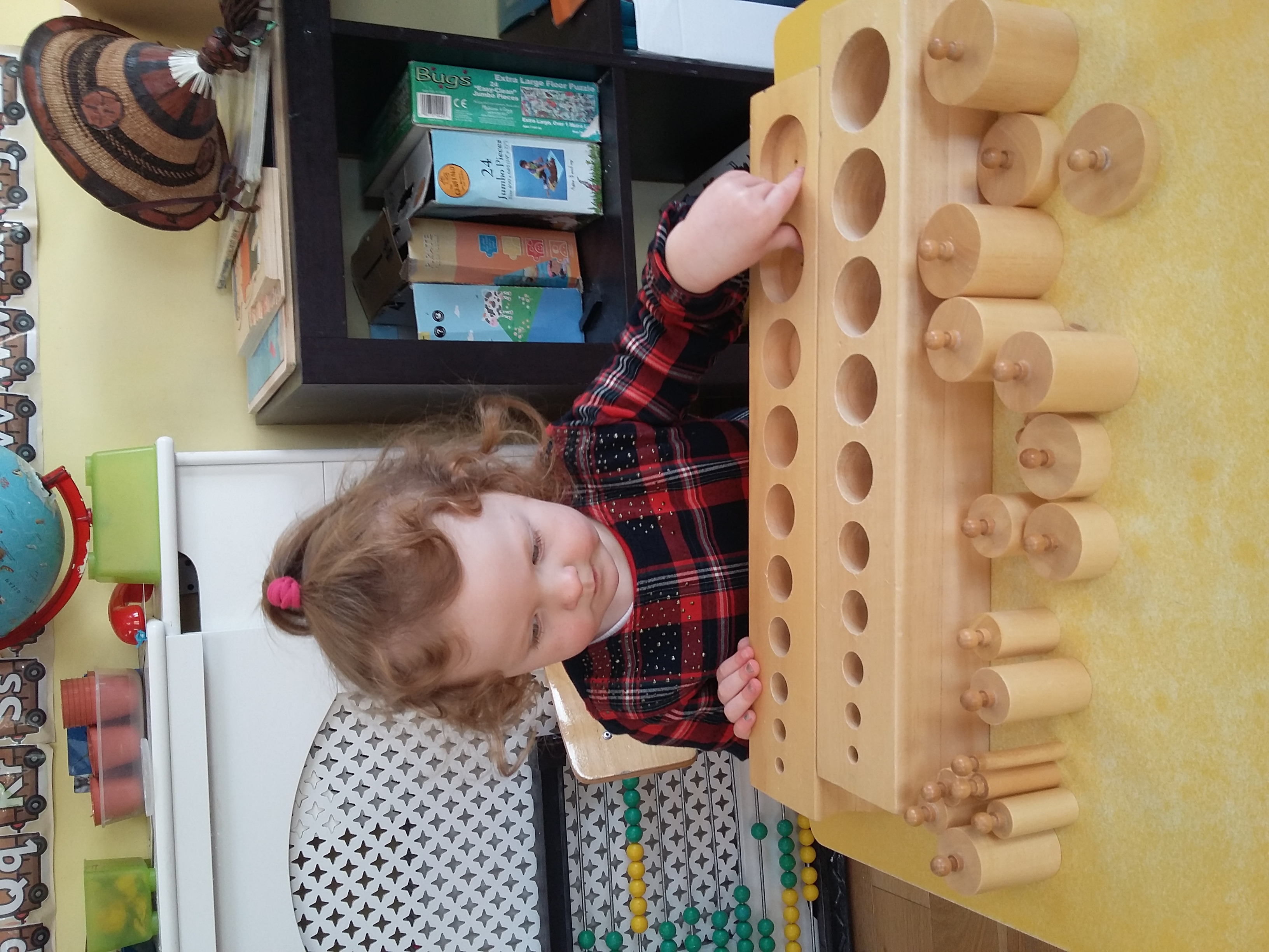 The Montessori Cylinders.