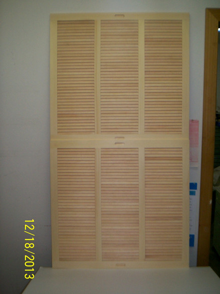 Another photo of the sliding shutters showing two of them as they would be installed.