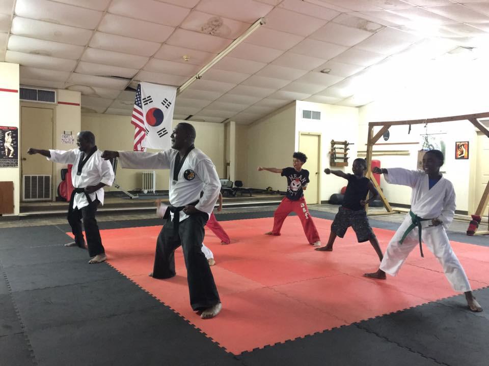 Master Billy Kelley teaching children karate