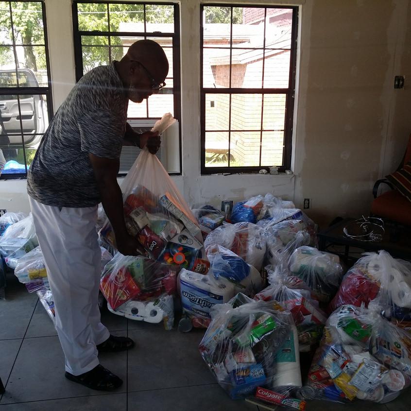 Hilton Kelley unloading donations