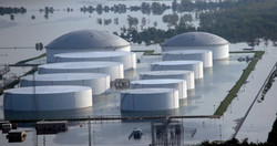 Holding tanks for a chemical company sit in floodwaters caused Tropical Storm Harvey on West Port Ar