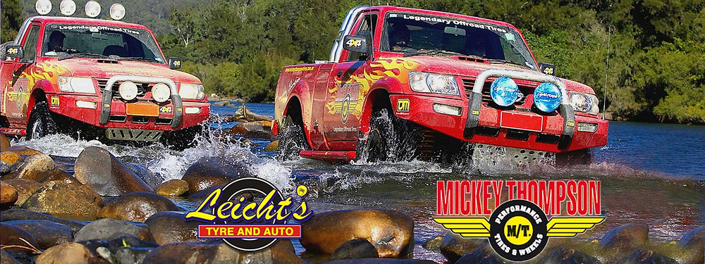 Leicht's Tyre and auto advertise two off road four wheel drive vehicles adventure through a river over boulders for Mickey Thompson Tyres in Brilliant online