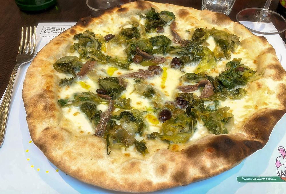 Thin-crust pizza at Emma